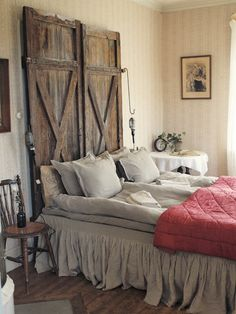 The natural bedroom, linen, reclaimed old doors as headboard