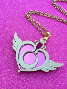 READY TO SHIP Sailor Moon Crisis Moon Compact Necklace by Ge3kedUp. , via Etsy.  Show everyone how much you love Sailor Moon with this Crisis Moon Compact Necklace    It is made from laser cut acrylic in gold and mirror pink  PLEASE NOTE: This does not open!  IN STOCK AND READY TO SHIP!  Perfect as a gift...Or just to spoil yourself :)  $30.00