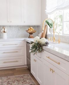 White cabinets, white marble counters, simple gold hardware, gold sink, and open windows...gorgeous kitchen! ❤️