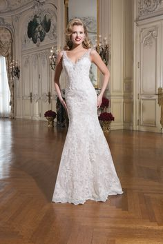 Justin Alexander - 8737. We love the heavily beaded neckline on this dress and the fit and flare shape.