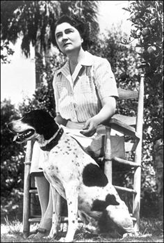 Marjorie Kinnan Rawlings with her dog: Cross Creek, Florida (194-)