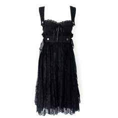 Preowned Dolce & Gabbana Black Corset Lace Dress ($1,699) ❤ liked on Polyvore featuring dresses, black, lace corset dress, preowned dresses, eyelet dress, pre owned dresses and lace cocktail dress
