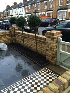 A complete design project for this London Front Garden paids Victorian mosaic tiling with contemporary paving. With the addition of a new front gate, yellow brick wall and planting - for a complete makeover. Victorian Front Garden, Victorian Terrace House, Edwardian House, 1930s House, Front Garden Path, Front Path, Garden Paths, Garden Tiles, Garden Paving