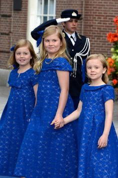 Princess Alexia (L), Princess Catharina Amalia and Princess Ariane (R) of the Netherlands depart the Nieuwe Kerk to return to the Royal Palace after the abdication of Queen Beatrix and the Inauguration of King Willem Alexander of the Netherlands