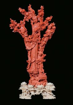 A red coral group with four Guanyin with blooming branches, China, Qing Dynasty, 19th century.PhotoCambi Casa dAste