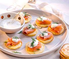 These Blinis with Smoked Salmon and Dill Creme Fraiche make the perfect appetiser for Christmas entertaining christmas food recipes appetizers Christmas Nibbles, Christmas Lunch Ideas, Christmas Recipes, Smoked Salmon Appetizer, Smoked Salmon Blinis, Party Food Buffet, Breakfast Buffet, Salmon Breakfast, Xmas Food