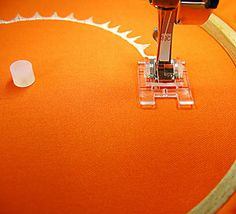 BERNINA Circular Embroidery Attachment #83 - Tip use 2 tiny squares cut away stabilizer on attachment Tack under fabric—so fabric will not rip and will turn easy