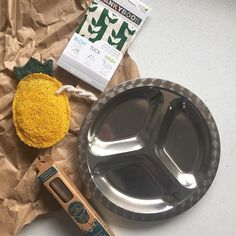 A little @tinyyellowbungalow #zerowastehome haul ... A  bamboo toothbrush for my daughter, a stainless plate for food at home and on the go, and the hanky book is a present I'm going to squirrel away for my mom's bday in April (shh!) Okay now let's talk about that pineapple  loofah sponge. I mean, dishes need to get done. Why not make it a little more fun?! (p.s. Head to my friend @whencaterpillarsfly's page and watch her video on loofah. Cool, right?) I try to buy most things locally but...
