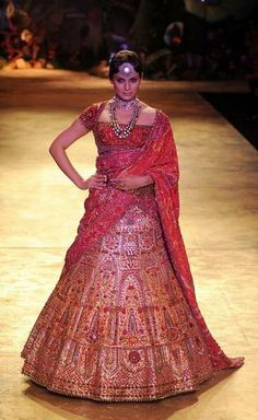 Red bridal Lahnga with embroideries in Thread, Swarovski elements, antique metal, Real pearls, Jade and Topaz.