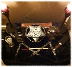 My Altar on the Seed moon. Capturing bad energies in the mirror below the pentagram to burn off in my cauldron.