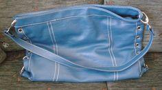 """Myydään uusi/käyttämätön turkoosinsininen PreModa-merkkinen käsi-/kesälaukku. (Ostohinta € 49,90)(Löysä malli - ei """"tukimateriaaleja"""")Kuvissa väri ei aivan vastaa todellisuutta - laukku näyttää sinisemmältä, kuin luonnossa.Materiaali: tekon"""