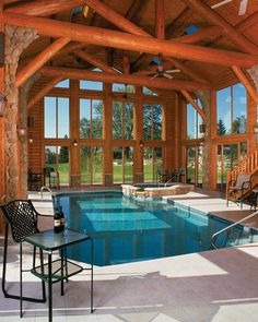 This large pool space is created by structural log trusses and log purlins.  The ceiling heights soar and the large panels of glass give you the feeling you are swimming outdoors.  Additional light is provided in the ceiling by automatic open sky lights.  Climate control is very important for pool spaces.