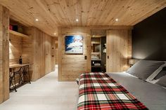 Spacious Chalet Gstaad Amaldi Neder Architectes Master Bedroom with Smart Wooden Furniture and Bathroom