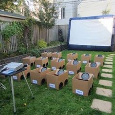 Drive in movie night for the toddler set, complete with cardboard box cars. Too cute