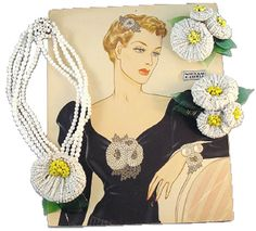 """Hess white glass bugle beaded flower necklace, circa 1940, with matching clips of white beads and green glass leaves, According to Larry Vrba, this design was a great favorite of Frank Hess'. Larry Austin original watercolor advertising illustration for Haskell seed bead and leaves bracelet and clip with foil """"Miriam Haskell"""" sticker, written in pencil on the back."""