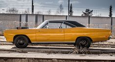 Lift-off hood and Black steel wheels what do you think is under the hood of course a 440 6BBL. This Bahama Yellow 1969 Road Runner is one astonishing Mopar!