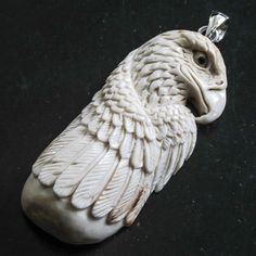Carved deer antler eagle pendant -- very nice can topper idea