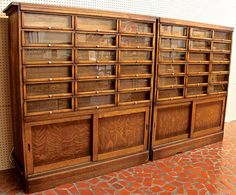 "ButtonArtMuseum.com - country store button cabinets, dating from around 1920, with eighteen glass fronted drawers over a pair of sliding doors. The front is made of oak and the sides are poplar. The drawers were designed to display cards of buttons behind the front panel for customers to see. Each drawer has a brass pull and a brass plated tag bracket. The large storage area at the bottom of the cabinet was for storing excess inventory. The dimensions are 57"" tall x 51 1/4"" wide x 18 1/2""…"