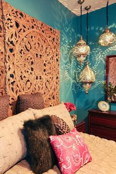 Rich teal walls, Moroccan lanterns and a dramatic headboard made from a pair of antique carved wooden panels makes this a vibrant retreat. - Home Decor Moroccan Home Decor, Moroccan Lanterns, Moroccan Interiors, Moroccan Design, Moroccan Room, Moroccan Furniture, Moroccan Lighting, Moroccan Lamp, Moroccan Style Bedroom