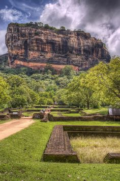 The ruins of the Sigiriya, or Lion's Rock, in the central Matale District of Sri Lanka, which was used as a monastery from around the 5th Century BC. The temple and monastery were built on a 'magma plug' - the rock shown.