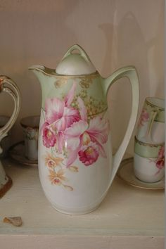 Contents of corner cupboard to include 3 incredible porcelain tea sets, RS Germany, Victoria Austria, and Nippon. Also included is a Haeger bowl, 8 stunning Richard Ginori Serra-Roma plates, Limoges, Nippon, teacups, plates, Japan, England…too many to name