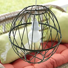 Light it up!  Two wire basket planters into a hanging lamp