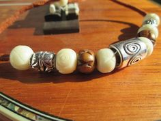Surfer, Boho, Bohemian, Beach Inspired Bracelet Featuring a Large Silver Plated  Bead, White Howlite Stone beads and Silver & Wood Beads on Leather. The size is adjustable by sliding the tightening bead to the desired length.