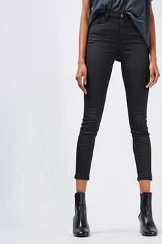 In a perennially cool high-waisted fit, the MOTO Jamie is the original rock n' roll skinny jean that we fell in love with all those years ago. Crafted in a super-stretchy cotton blend and coated in black for a leather look feel – the iconic style includes multiple pockets, a top button fly and works for all occasions. #Topshop