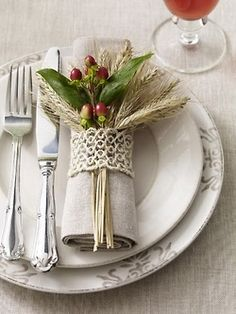 like the idea of tucking flowers in ribbon around napkin...only thing is...what happens to the flower pieces when they pull the napkin out? They would need to be tied together underneath.