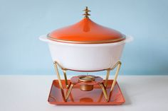 Vintage Pyrex Fire King casserole dish with warming.  Mad for the pull on the lid.