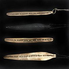 Necklaces we love. Bronze pendants by Julie Cohn Design.
