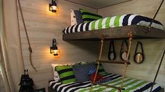 DIY Suspended Bunk Beds - Bunk beds are a lot of fun for kids, but they're even more fun when you suspend them from the walls! These bunk beds are made to look like your child is sleeping on a pirate's ship.