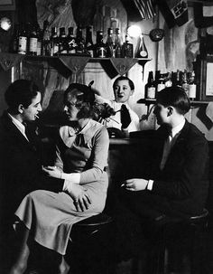 """Brassaï. Lulu de Montparnasse dressed with a smoking with a woman at the """"Monocle"""", c.1933"""