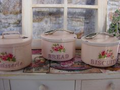 Dollhouse Miniature Shabby Chic Vintage Style Metal Bread Box Pink with Rose Motif. $21.95, via Etsy.