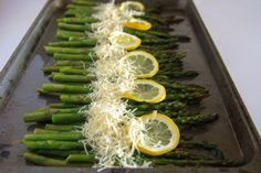 Baked Asparagus With Lemon Butter & Parmesan - 2bunches asparagus•1lemon•4T butter•olive oil•S&P•½C Parmesan cheese - Rinse asparagus&break off ends.Put in baking dish,drizzle w/oil&sprinkle w/s&p. Squeeze ½ a lemon on. Line top third of asparagus w/lemon slices. Slice butter&line center of asparagus w/butter.Bake@400° for 12mins or until tender. Remove from oven&set oven to broil. Sprinkle asparagus w/Parmesan&broil 2-3mins or until cheese is melted&golden. Serves 6-8