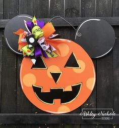 Welcome your friends, family, and trick-or-treaters with our cute and whimsical Jack-O-Lantern Mickey door hanger. Made of plywood and painted with outdoor quality paint. Painted black on the back for that polished look. 25 tall x 28 wide Diy Halloween Door Decorations, Halloween Door Hangers, Halloween Signs, Halloween Crafts, Halloween Stuff, Disney Decorations, Halloween Table, Halloween Birthday, Easy Halloween