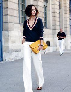 White pants navy sweater