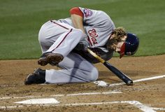 Plunked -        Washington Nationals' Jayson Werth falls after being hit by a pitch against the San Diego Padres during the second inning May 15 in San Diego.  - © Gregory Bull/AP
