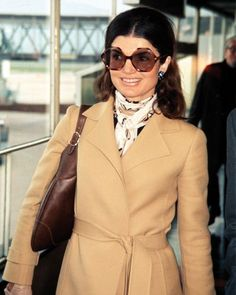 Signature Jackie O - trench, Hermes scarf, sunglasses, and Gucci Bag.