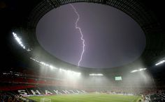 A bolt of lightning streaks across the sky above the Donbass Arena in Donetsk after the Euro 2012 match between France and Ukraine was suspended due to bad weather. Picture: Action Images / Carl Recine