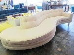 1950-60s serpentine sofa with lovely new neutral fabric.  Tufting along the back.