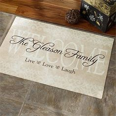 Personalized Family Door Mats - Live Love and Laugh . $17.20. Bestow your family mantra to all who enter your home with our lovely, exclusive Live, Love, Laugh Personalized Doormat.A perfect accent piece to create a loving welcome for friends and family, indoors or outdoors all year round!This impressive piece of art boldly displays your family name over an elegant, neutral backdrop, making it a perfect accent for any front door.