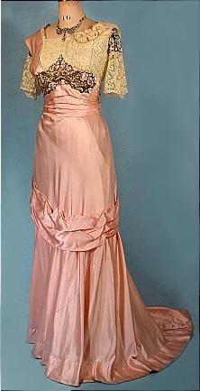 Beaded pink silk satin evening gown (front) with Valenciennes lace bodice and sleeves, c. 1912.