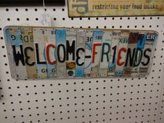 "$16 -  Up-cycled License Plate sign ""Welcome Friends"" - A unique use of license plate - perfect for Man-Cave. ***** In Booth G21 at Main Street Antique Mall 7260 E Main St (east of Power RD on MAIN STREET) Mesa Az 85207 **** Open 7 days a week 10:00AM-5:30PM **** Call for more information 480 924 1122 **** We Accept cash, debit, VISA, Mastercard, Discover or American Express"
