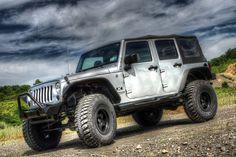 "Jeep JK w/ 2.5"" X Factor lift, 37"" tires, and Bushwacker Flat Style Flares"