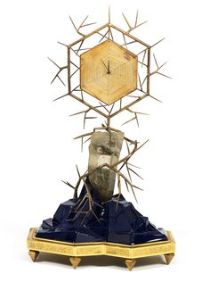 Have you decided that Time is NOT your friend?  Then I've found the clock for you! Andre Dubreuil - Table clock, surrounded by brambles and sitting on black rock. Hmmm...