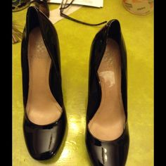 Vince Camuto classic pump Black patent leather pump. Worn once beautiful classy patent leather pump. Perfect for that right business suit, favorite jeans or hit the club. Never can go wrong with this CLASSIC PUMP Vince Camuto Shoes