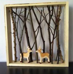 Takjes en houten hertjes in een foto lijstjes