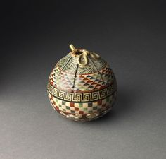 A ceramic kōro (incense burner) painted in coloured enamel in the form of a Japanese silk bag Impressed seal mark: Kahin Shiryū. Japan 19th century Edo period