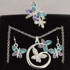 "3piece blue butterfly set Set includes necklace 161/2""L with 31/2""L extender included, Earrings and ring size 8. Silvertone with Faux stones and rhinestones.brand new. Only taken out for pictures. BTW: This closet follows the rules:   no trades, not supported by posh  no PayPal  AGAINST the rules  no lowballing  it's RUDE   yes, it's available  Jewelry"